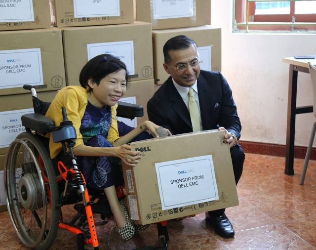 NT&T joins DellEMC in a charity event to distribute computers to the disabled people in The Will to Live Center.
